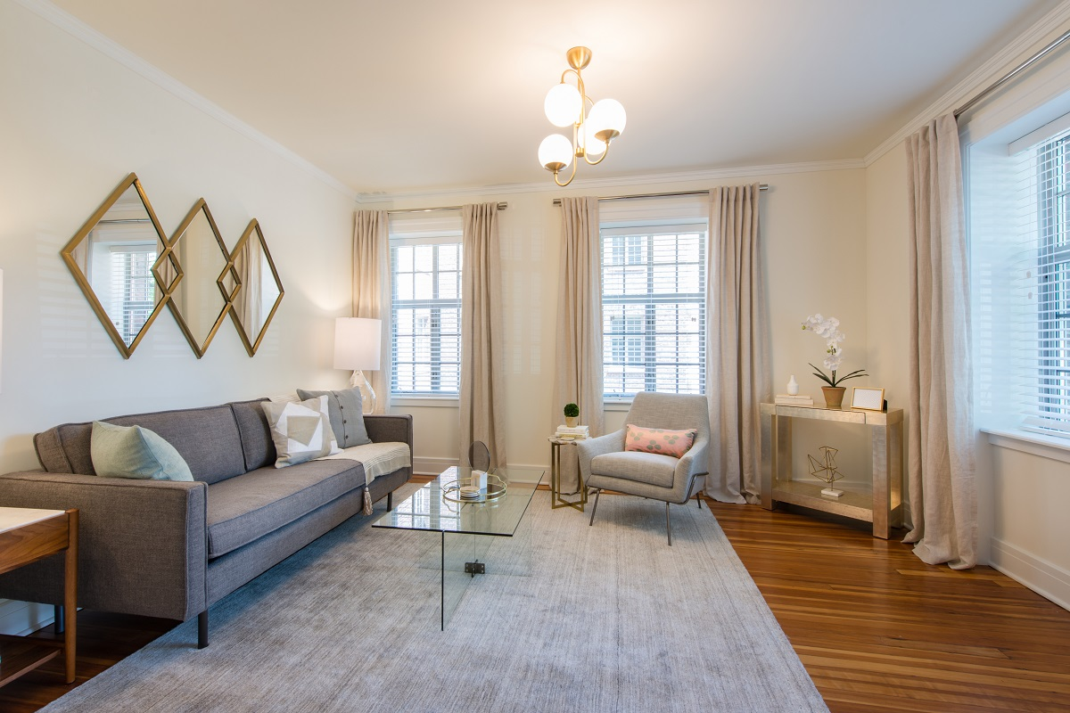 Beautifully-restored hardware flooring accentuate the spacious living room