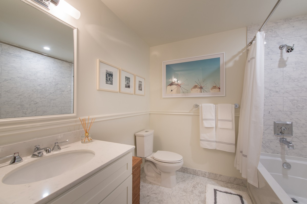 Designer chrome fixtures compliment siltstone floor and shower
