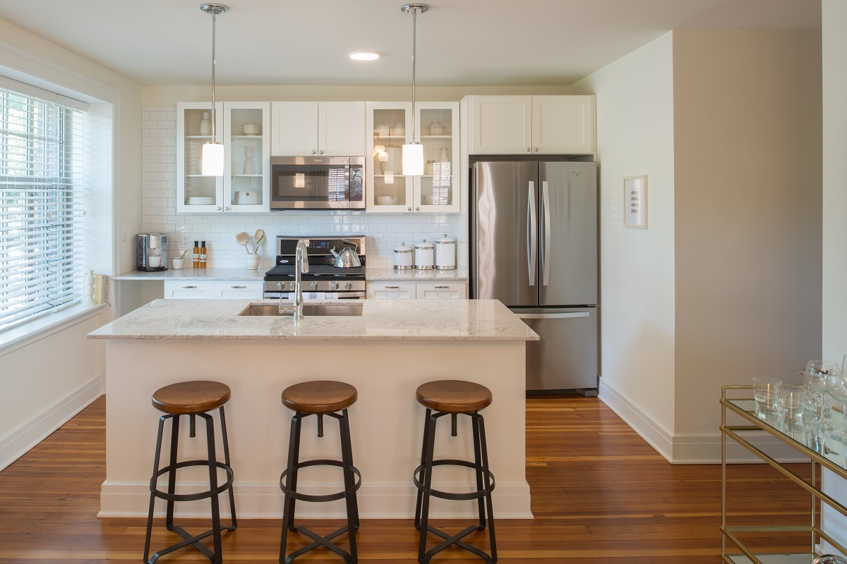 Silestone counters and white shaker cabinets compliment every feature