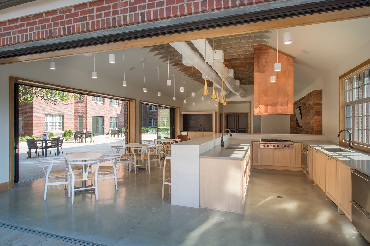 Gourmet kitchen with Wolf appliances and copper hood